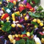 Salad with black beans, corn, tomatoes, cilantro and jalapeños