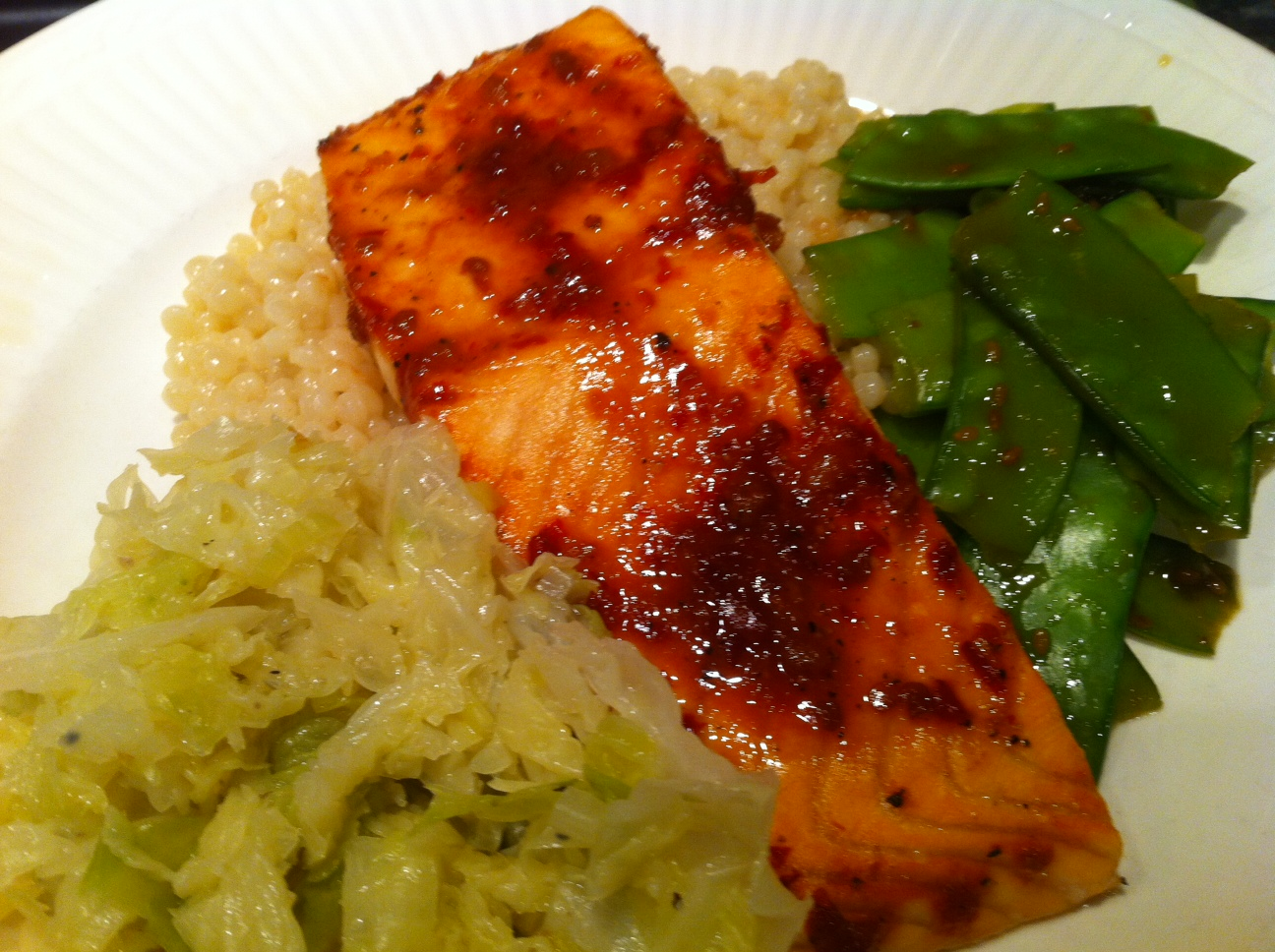 Chili Garlic Glazed Salmon with Israeli Pearl Couscous, Sauteed Cabbage and Snow Peas