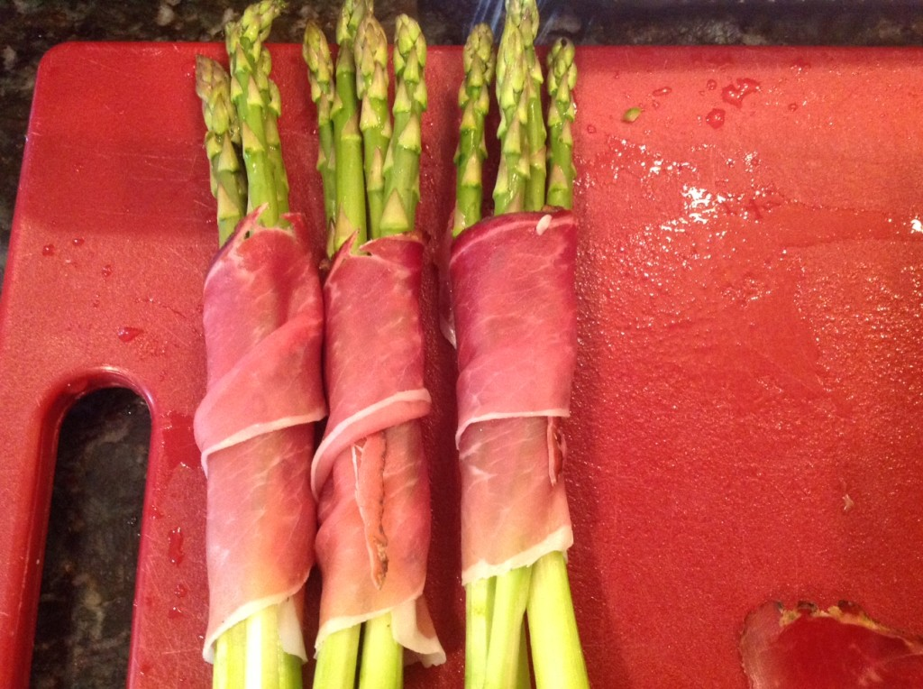 asparagus wrapped with prosciutto and topped with parmesan